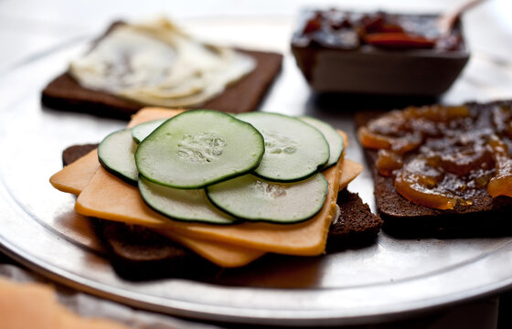 Close up of cheddar, cucumber and marmalade sandwich with pickle