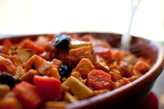 Close up of sweet potato, carrot and dried fruit casserole