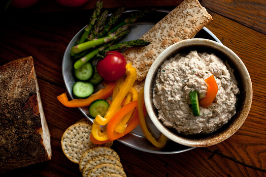 Overhead view of tuna dip served with vegetables and crackers