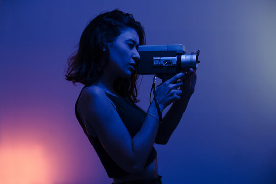 Woman filming with a Super 8mm camera