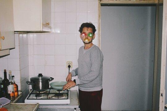Strange person in kitchen