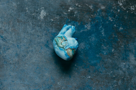 heart representing the earth on textured background of the earth representing our planet and the uncertainty of this moment covid 19.