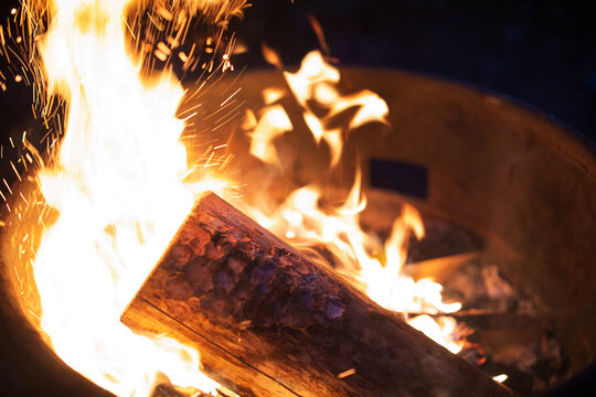 Close up image of a bonfire crackling and sparking