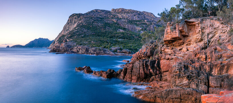 early morning light on the coastal cliffs on Freycinet Peninsula Tasmania