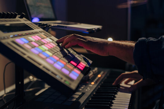 Man creating music with a drum pad