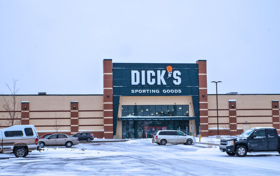 BRAINERD, MN - 19 DEC 2019: Dicks Sporting Goods store entrance in winter with snow on parking lot. Dicks is an American sporting goods retail company, based in Pennsylvania.
