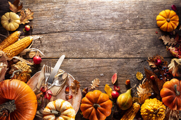 Thanksgiving Board - Table Setting With Silverware And Pumpkins On Aged Wooden Plank
