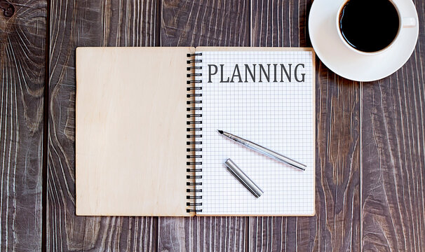 Word Writing Text PLANNING with pen and cofee. business concept