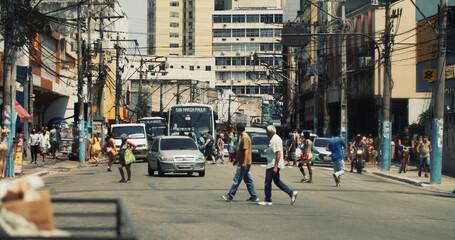 RIO DE JANEIRO, BRAZIL - Oct 06, 2020: People walking on the streets of a poor city in Rio de Janeiro