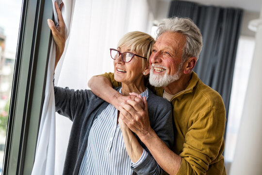 Happy senior couple in love hugging and bonding with true emotions