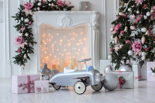 Christmas or NewYear background - toy airplane, fir-tree, garlands, lantern, gif box - holiday invitation background