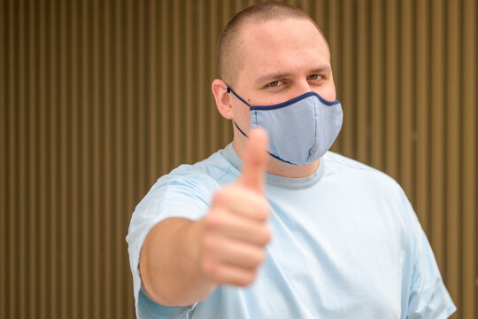 Upbeat positive young man giving thumbs up gesture