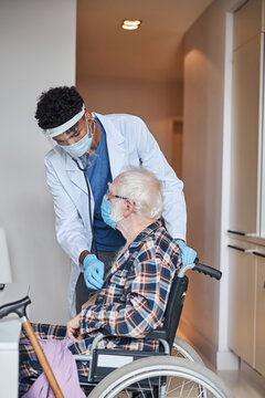 Doctor performing a routine cardiovascular examination of a senior patient