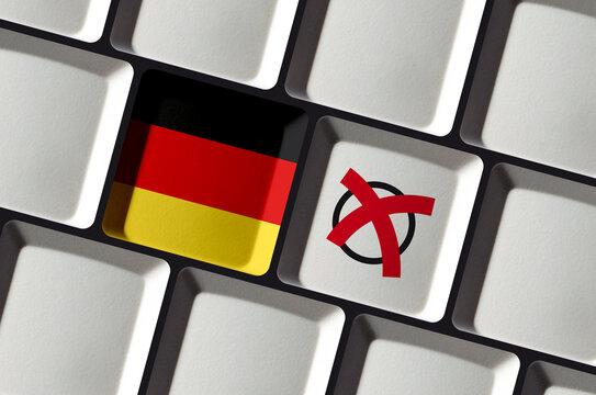 German Election or referendum in Germany- German flag on computer keyboard online internet