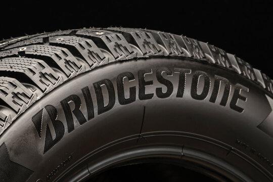 Krasnoyarsk, Russia, August 19, 2020: Bridgestone logo on the sidewall of the new tire, black background