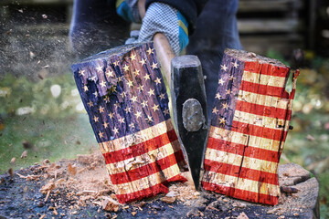 Wooden block with American flag is split in two halves with an axe, metaphor for the divided country after the election