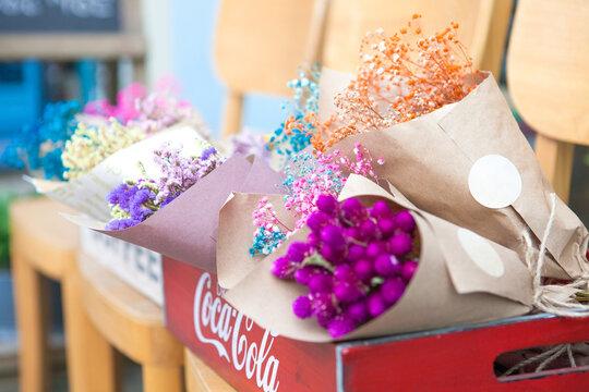 Batch wrapped bouquet of flowers in flower shop