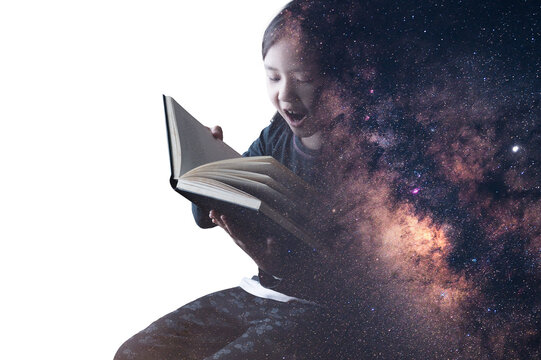 The double exposure image of the boy reading a book overlay with the milky way galaxy image.
