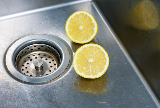 Apply fresh lemon to the clean sink top to help the sink clean better and shinier.