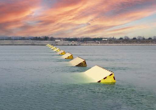 The MOSE System in Venice, Italy at the sunset for defense against high waters. Barrier against the high water in the defense of Venice Lagoon. New generation of industrial flood prevention system.