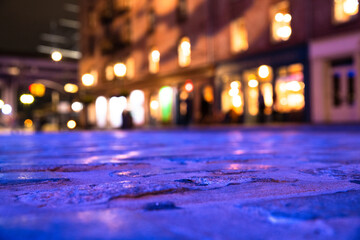 Blurred backdrop image of cobblestone street and lights from New York City. Fotomurales