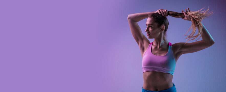 Flyer. Young sportive woman training isolated on gradient studio background in neon light. Athletic and graceful. Modern sport, action, motion, youth concept. Beautiful caucasian woman practicing.