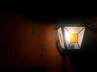 wall brick light muted comfort lantern old retro candle glow fire in the dark mystery mysterious fabulous england comfort house evening interior exterior decor antiquity rarity retro lighting village  Fotomurales