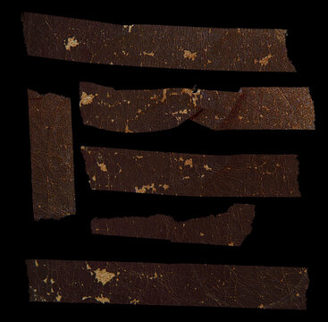 set of old, withered and crumbled brown stickers on black background with leather look. grungy vintage stickies isolated. real macro photo.