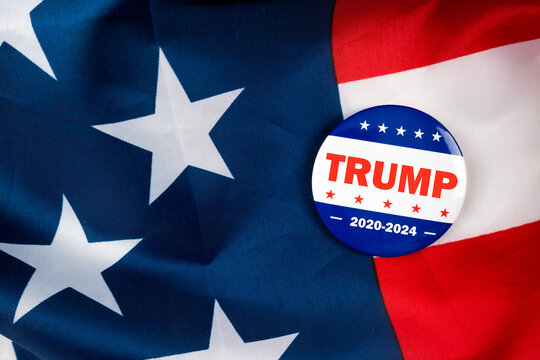 trump 2020-2024 text on american election vote button on united states national flag. 2020 presidential election concept.