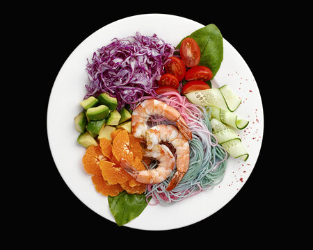 multicolored rainbow Asian noodles with shrimp and vegetables salad. High quality photo