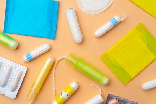 Flat lay of Pads, tampons and pills