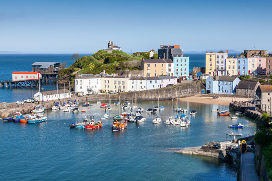 Tenby Harbour which is a popular seaside resort town in Pembrokeshire South Wales and a popular travel destination tourist attraction landmark, stock photo image