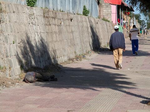 A homeless, man sleeps on the street of Addis Ababa, Ethiopia.