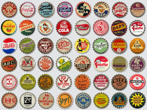 Collection of old used vintage soda and beer bottle caps on gray background on October 18, 2020 in Vilnius, Lithuania