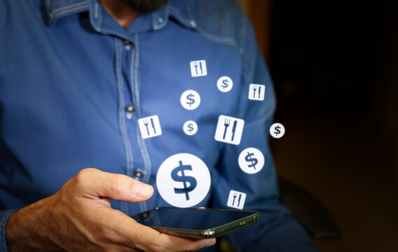 Man using a smartphone with US dollar and food icons with fork and knife. Concept of online food ordering