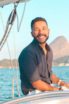 Fancy Young bearded latino adult  in a boat at Guanabara Bay in Rio de Janeiro