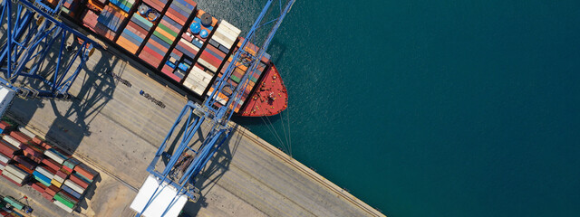 Fototapeta Aerial top down ultra wide photo of industrial cargo container ship loading in logistics terminal port