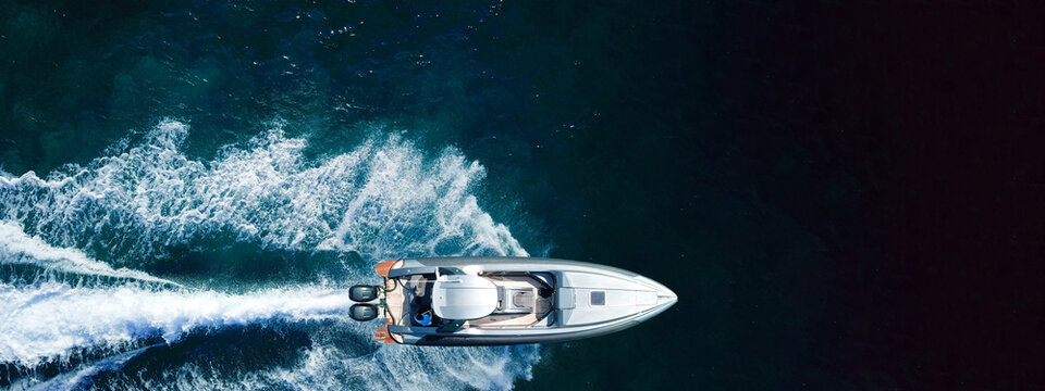 Aerial drone ultra wide photo of luxury inflatable speed boat cruising deep blue Aegean sea, Greece