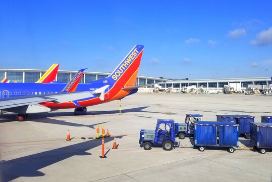 New Orleans, Louisiana, U.S.A - January 31, 2020 - Southwest Airlines planes next to a luggage carrier at the airport