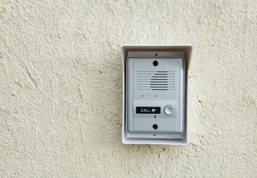 Close up intercom access control system setting on wall for smart home security system.