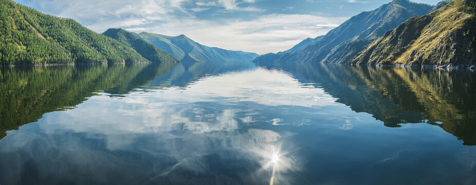 Panoramic view, sunny day. Sayano-Shushensky reservoir on the Yenisei River in Siberia.