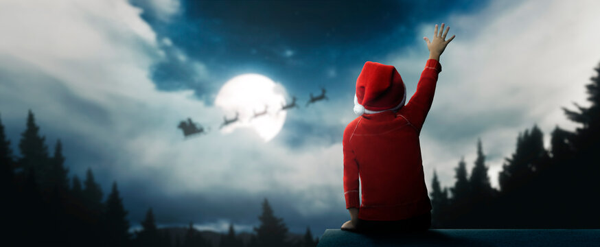 child surprised to see santa claus on beautiful christmas night under moonlight