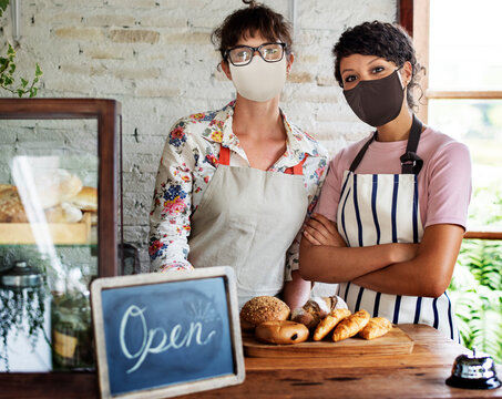 Bakery shop open post covid pandemic new normal staff in face masks