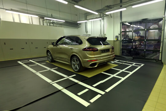 Moscow. February 2019. Porsche Cayenne in service center. Installing and calibration of surround view 360 Camera. rear front and side cameras setup. Calibration stand.