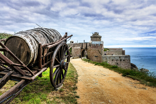 Medieval Castle Fort La Latte with old barrel on cart in Brittany, Cap Frehel, France