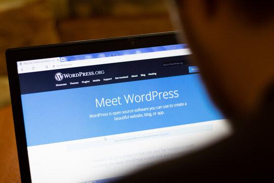 New York, USA - 9 April 2020: WordPress website on laptop screen close up. Man using service on display, blurry background, Illustrative Editorial
