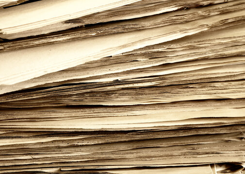 Close up of a newspaper pages, paper, stack of newspapers.
