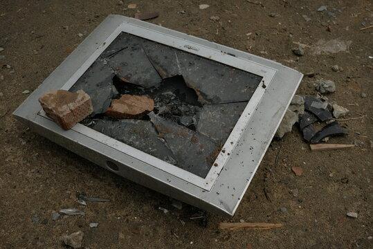 stone smashed tv on the ground