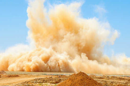 Dust storm after detonator blast in the desert