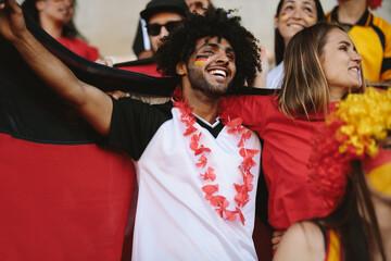 Group of german soccer fans cheering in stadium